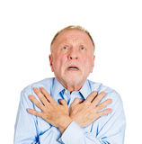 Older man pleading, begging up above Stock Photo