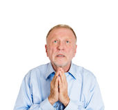 Older man pleading, begging up above Royalty Free Stock Photography