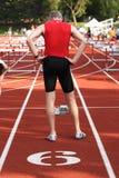 An older man preparing to run a race Royalty Free Stock Photos