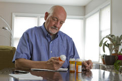 Older man with prescription medications, horizontal Royalty Free Stock Images