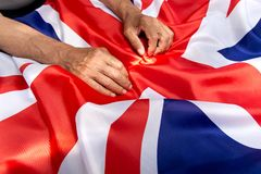 The older man put his hands on the UK flag. The older man put his hands on the UK flag Stock Photography