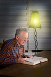 Older man reading a book Stock Photography