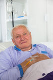 Older man receives infusion Royalty Free Stock Image