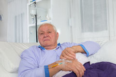Older man receives infusion Royalty Free Stock Photography