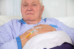 Older man receives infusion Royalty Free Stock Photos
