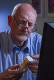 Older man refilling prescription online, vertical Royalty Free Stock Photography
