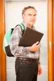 Older man representing lifelong learning. Man with school bag sm Stock Photos