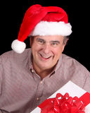 Older man with Santa hat and present Stock Photography