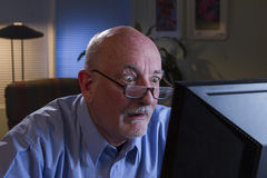 Older man shocked with content on his computer, horizontal Stock Images