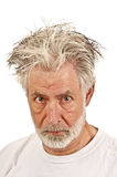 Older Man Showing Anger Or Suspicion. An old man with messy hair showing anger or suspicion Royalty Free Stock Photography