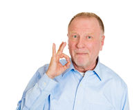 Older man showing sign, let's get drunk Stock Images