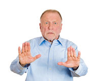 Older man showing stop sign Royalty Free Stock Photo