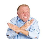 Older man showing X sign Royalty Free Stock Photography