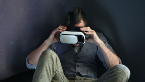 Older man sitting on couch with virtual reality glasses stock footage