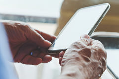 Older man with smartphone Stock Images