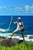 Older man standing  on the beach Royalty Free Stock Photos
