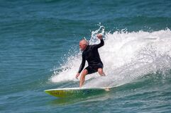 Older man surfing.