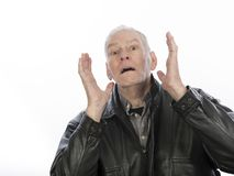 Mature man with expression of dismay. Older man with surprised, shocked, unhappy expression isolated on white background stock images