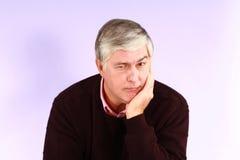 Older man thinking Stock Photo