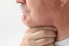 Older man with throat pain stock photos