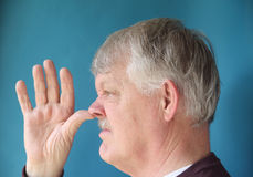 Older man thumbs his nose Royalty Free Stock Photo