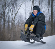Older Man Tobogganing Stock Photography
