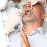 Older man with toothache at the dentist Royalty Free Stock Photos