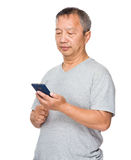 Older man use of the mobile phone Royalty Free Stock Images