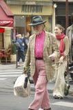 Older man walking down street with bag, Paris, France Royalty Free Stock Images