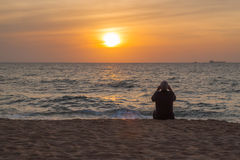Older man watching at the ocean sunset royalty free stock images
