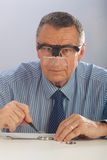 Watchmaker With Glasses Stock Image