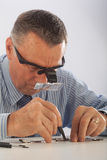 Man Repairing Watch Stock Photo
