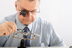 Older Man Repairing Watchmaker Stock Image