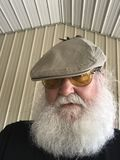 Older man with beard and hat Stock Photos