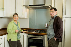 Older man and woman couple in modern kitchen Stock Image