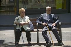 Older man and women with canes sit on bench near La Rambla, Barcelona, Spain Royalty Free Stock Images