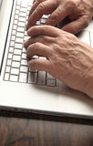 Older man works on laptop Royalty Free Stock Photo
