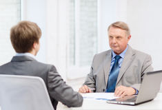 Older man and young man having meeting in office Royalty Free Stock Photos