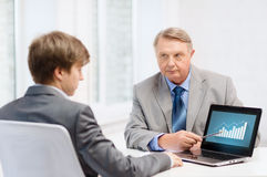 Older man and young man with laptop computer Royalty Free Stock Images