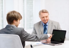 Older man and young man with laptop computer Stock Photography