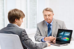 Older man and young man with laptop computer Stock Image