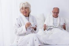 Older marriage in bedroom Stock Image