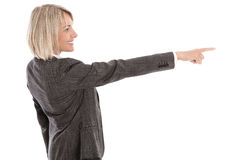 Older or mature isolated businesswoman pointing with finger. Stock Photo