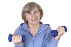 Older mature woman lifting weight Stock Image