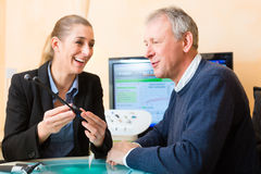 Deaf man makes a hearing test. Older men or pensioner with a hearing problem make a hearing test and may need a hearing aid Royalty Free Stock Photo