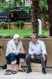 Older men sit and talk Royalty Free Stock Images