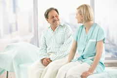 Older patient talking to nurse Royalty Free Stock Photo
