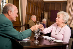 Older people celebrating anniversary royalty free stock photography