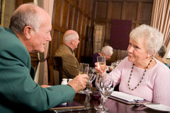 Older people celebrating together Royalty Free Stock Photography