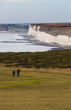 Older people couple discover Seven Sisters Cliffs in Sussex Engl Royalty Free Stock Photos